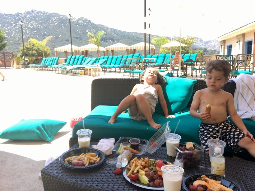 Miles and London lounging in their Lassig smart Swim Tanksuit and Board Shorts during our #endless summer adventure.