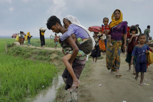 Rohingya refugees from Myanmar's Rakhine state reach the border near Teknaf, Bangladesh, on Sept.