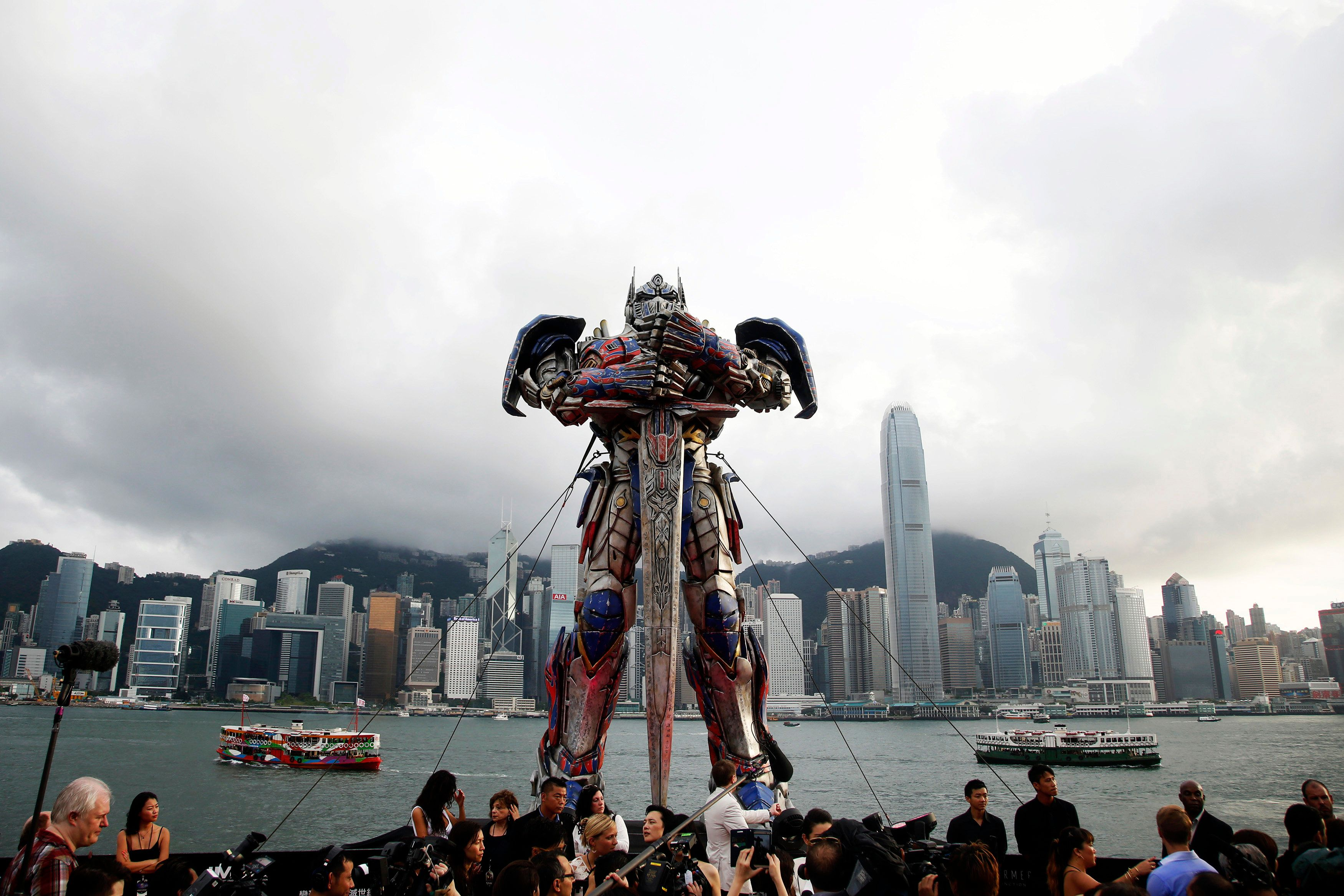 "A 21-foot tall model of the Transformers character Optimus Prime is displayed on the red carpet before the world premiere of the film ""Transformers: Age of Extinction"" in Hong Kong June 19, 2014. REUTERS/Tyrone Siu (CHINA - Tags: ENTERTAINMENT TPX IMAGES OF THE DAY)"