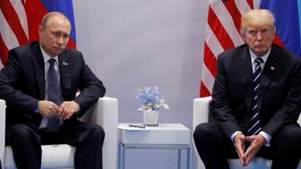 U.S. President Donald Trump meets with Russian President Vladimir Putin during their bilateral meeting at the G20 summit in Hamburg, Germany July 7, 2017. REUTERS/Carlos Barria