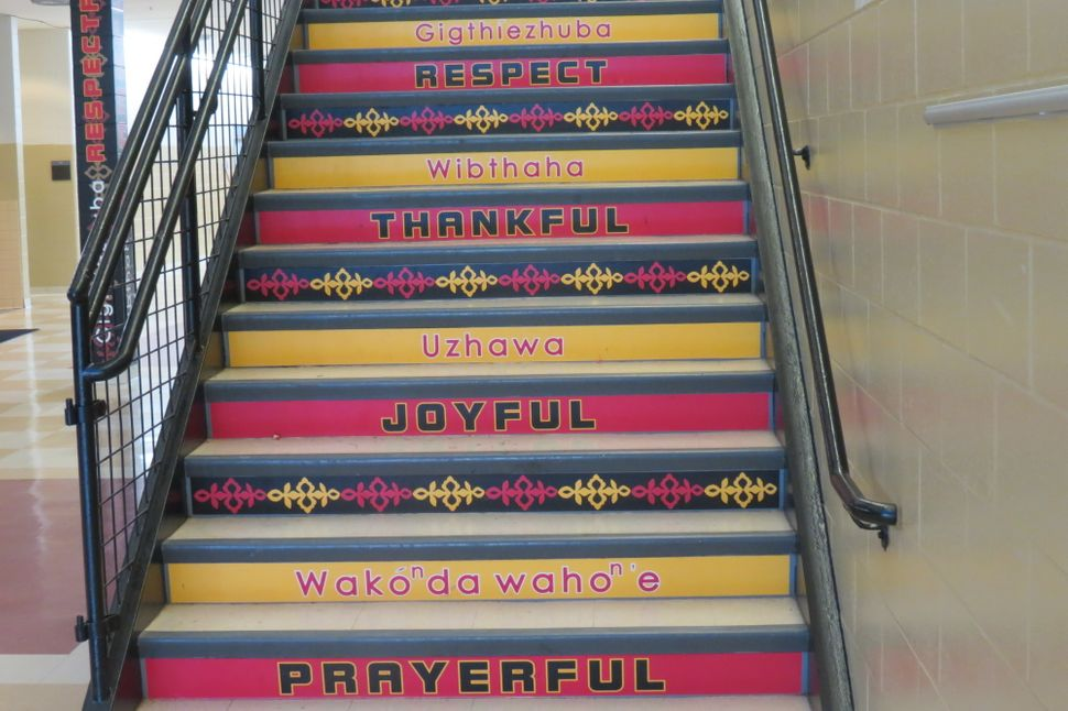 Stairs in Umonhon Nation Public School with words in English and Umonhon.