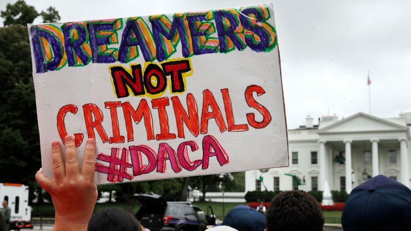 Supporters of DACA rally in front of the White House to protest the Trump Administration's repeal of DACA.