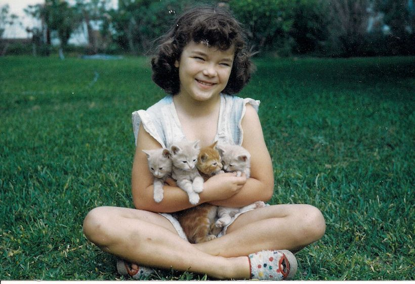 Flicka at 8 years old with her first set of furry friends