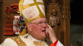 Roman Catholic Cardinal Timothy Dolan wipes his eye during the funeral mass for the late Cardinal Edward Egan, Archbishop-Emeritus, at St. Patrick's Cathedral in midtown Manhattan in New York, March 10, 2015. REUTERS/Brendan McDermid (UNITED STATES  - Tags: RELIGION OBITUARY)