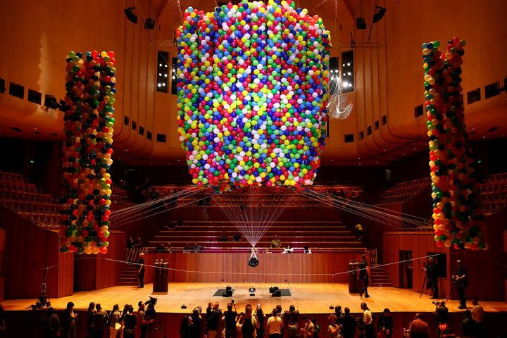Artist Gets Lifted Off The Ground By 20,000 Balloons In Beautifully Colourful