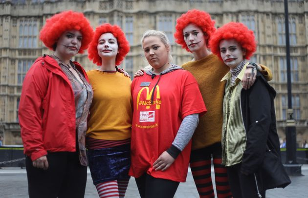 Jess Bower (centre) who is on strike from the McDonald's restaurant in Crayford, SE London, with supporters...