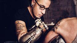 Guinness World Records: First Prosthetic Tattoo Gun Arm, World's Longest Eyelash And