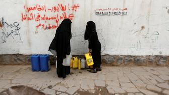 "Women carry jerrycans after they filled them up with drinking water from a charity tap, amid a cholera outbreak, in Sanaa, Yemen, July 10, 2017. REUTERS/Khaled Abdullah        SEARCH ""CHOLERA KHALED"" FOR THIS STORY. SEARCH ""WIDER IMAGE"" FOR ALL STORIES."
