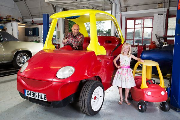 Brits Geof Bitmead (pictured) and John Bitmead built the world's largest Cozy Coupe: 8 feet, 10.2 inches. <br>