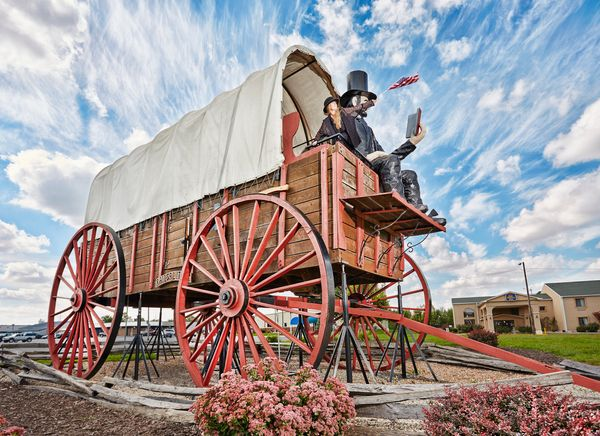 The world's largest covered wagon measures 40 feet long, 12 feet wide and 25 feet tall. David Bentley built the wagon by hand