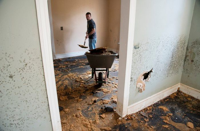 Brent Davis helps clean out a home damaged by floodwaters from Hurricane Matthew in Nichols, South Carolina, in October 2016.
