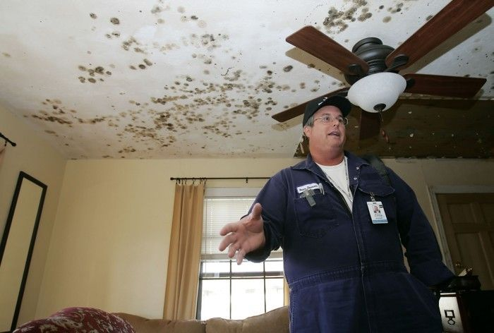 After Hurricane Rita in 2005, a resident of Groves, Texas, appears in his moldy living room.