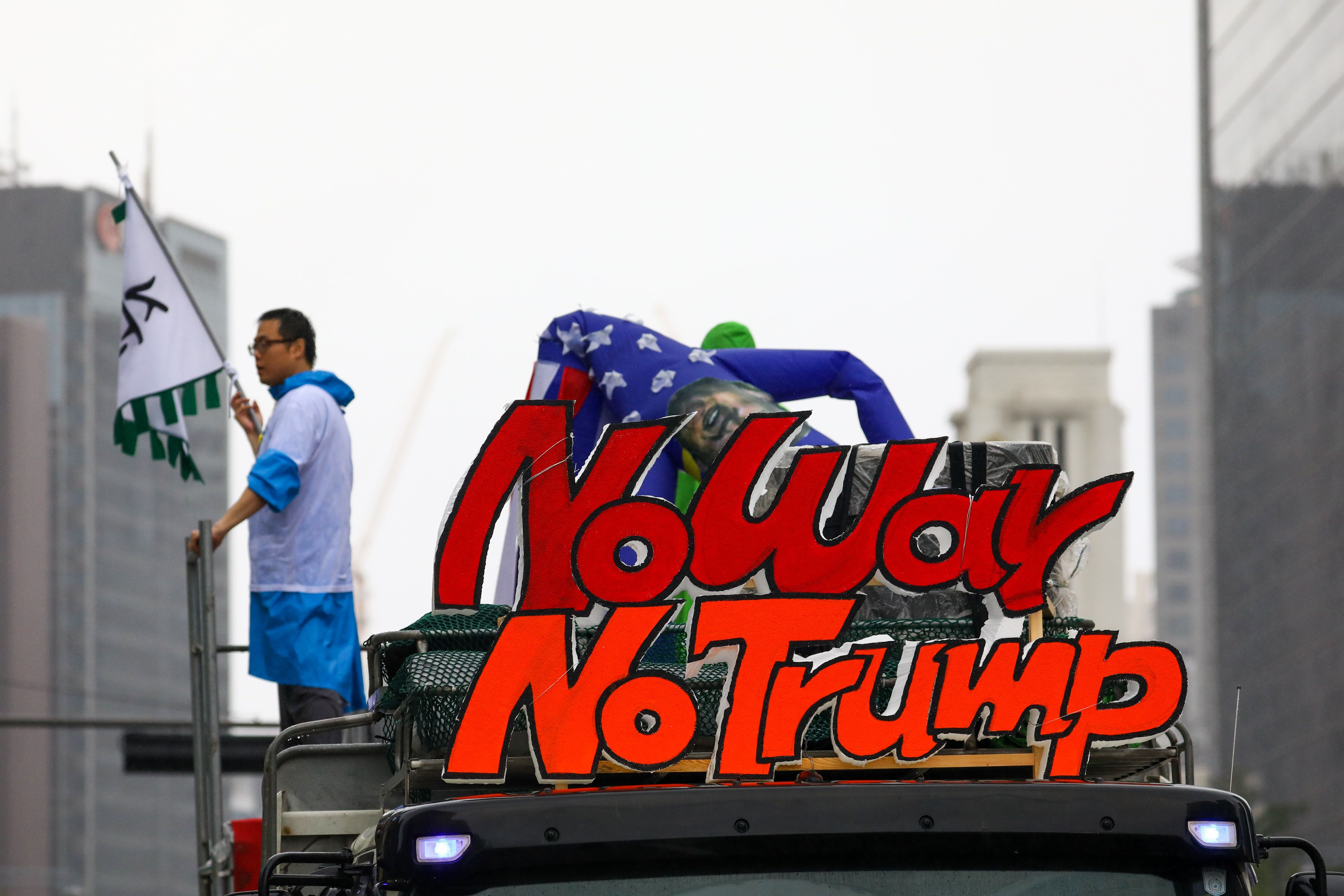 A truck carries a placard reading 'No War No Trump' following a rally against the deployment of the Terminal High-Altitude Area Defense (THAAD) system in Seoul, South Korea, on Tuesday, Aug. 15, 2017.In a speech on Tuesday marking the anniversary of the end of Japanese occupation in the 1940s, South Korean President Moon Jae-in said that any military action against Kim Jong Un's regime requires his nation's approval, and vowed to prevent war at all costs. Photographer: SeongJoon Cho/Bloomberg via Getty Images