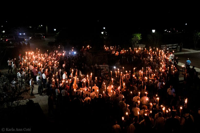 <em>Hundreds of white supremacists gather at a rally in Charlottesville to protest the removal of a confederate statue. Photo