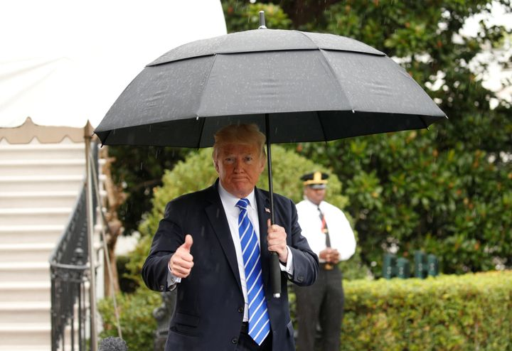 President Donald Trump gives a thumbs up as he departs the White House to North Dakota on Sept. 6, 2017.
