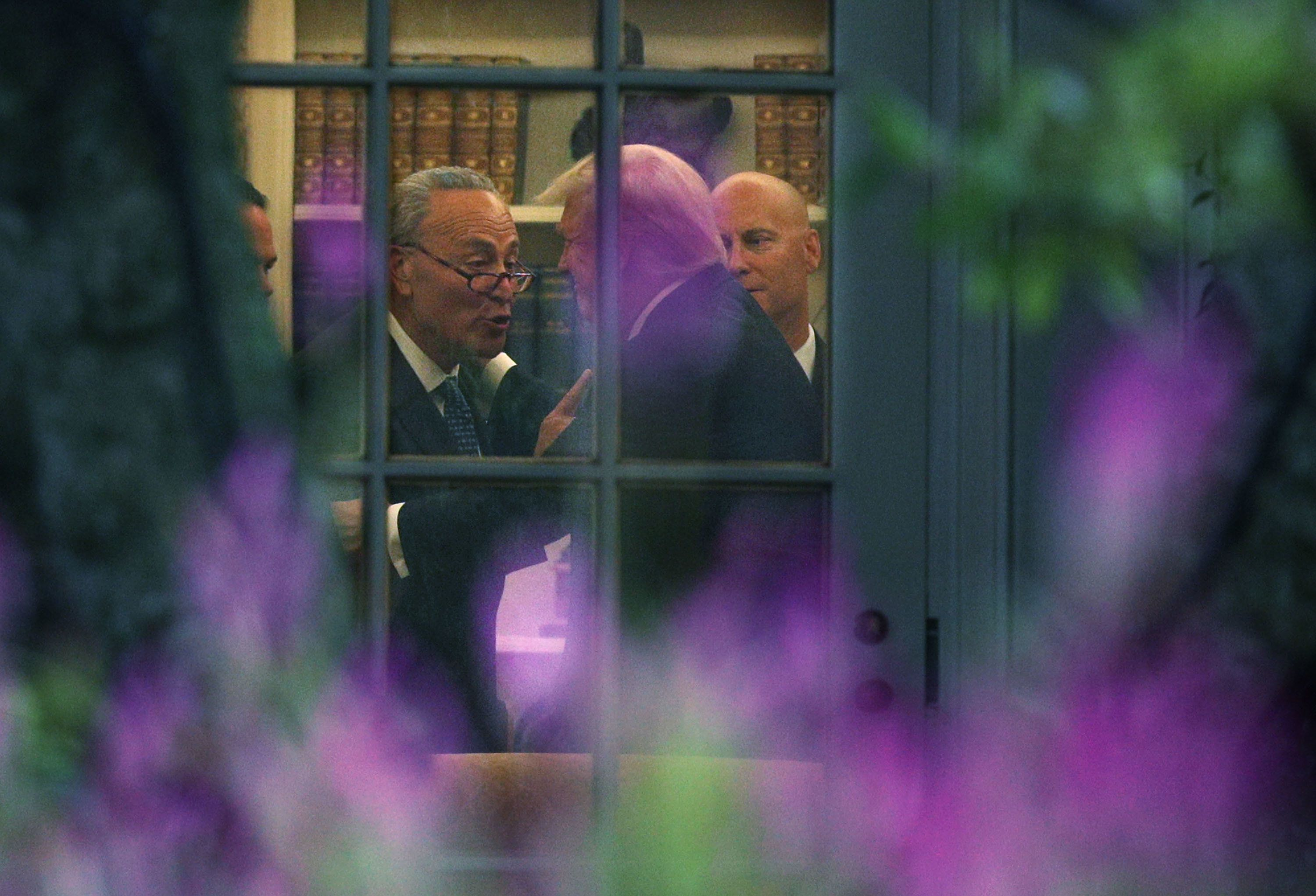 Senate Minority Leader Chuck Schumer (D-N.Y.) makes a point to President Donald Trump in the Oval Office on Wednesday.&n