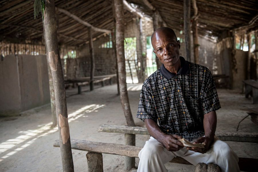 Jean-de-Dieu Liyande a former sleeping sickness patient sits in his village church