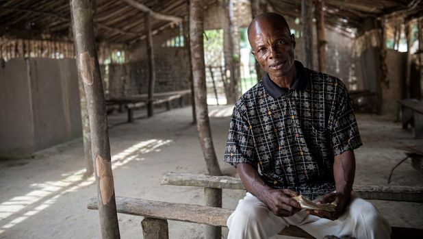 Jean-de-Dieu Liyande a former sleeping sickness patient sits in his village church