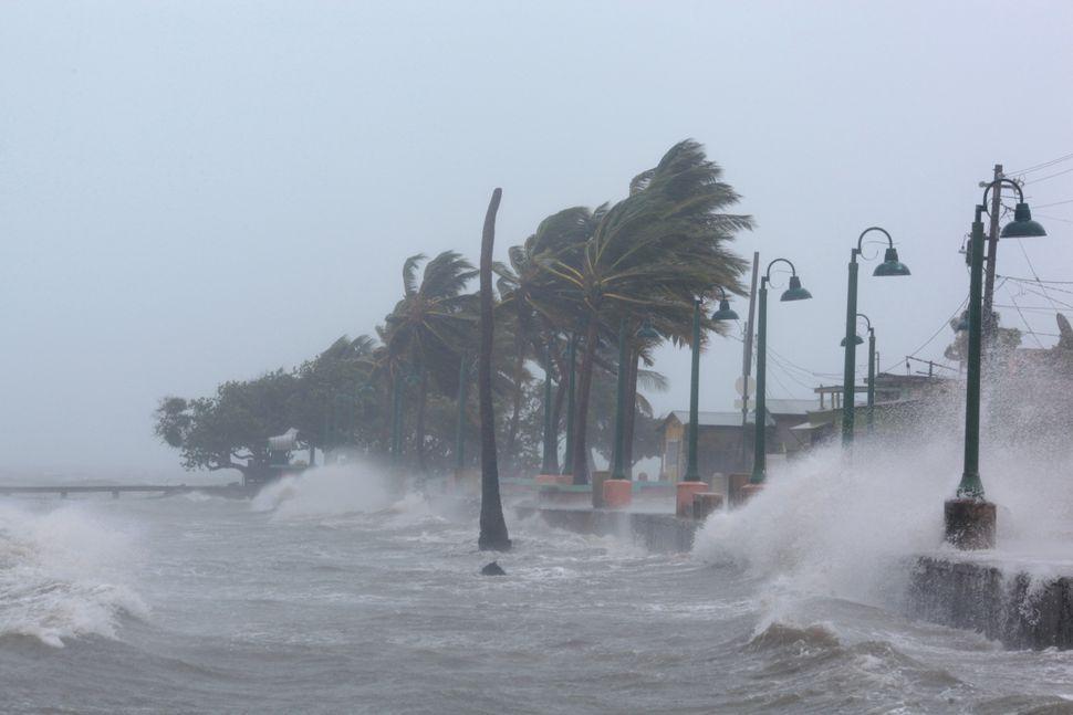 Waves crash against the seawall in Fajardo, Puerto Rico, as Hurricane Irma slammed across islands in the northern Caribbean o