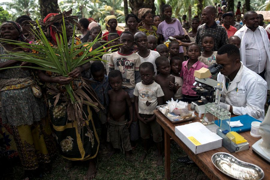 Doctors test for sleeping sickness in a remote Congolese village.