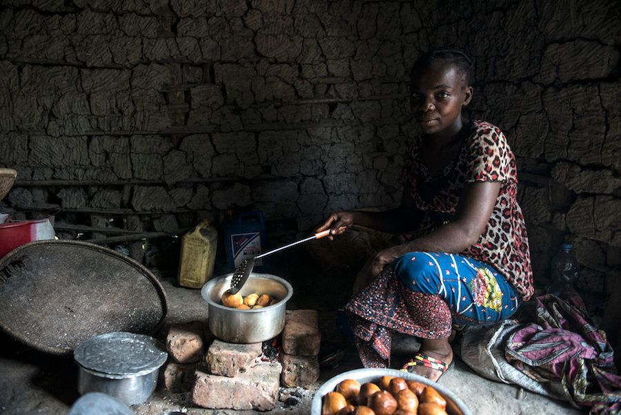A mother whose sons contracted sleeping sickness in the village of Isangi makes doughnuts in her kitchen.