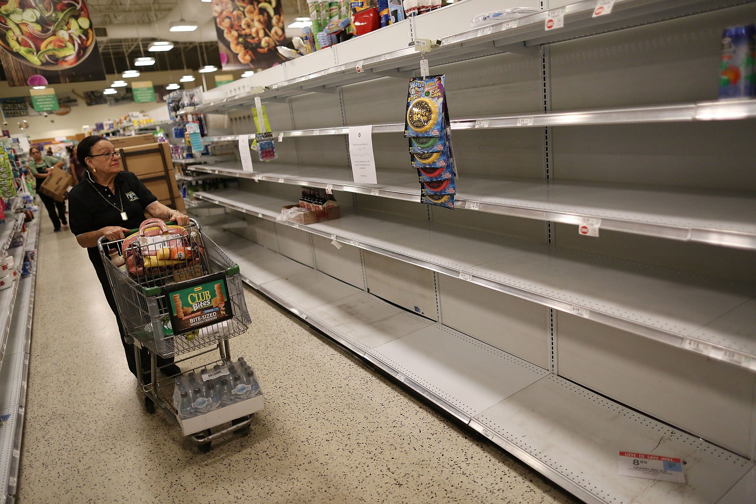 MIAMI, FL - SEPTEMBER 06:  Bare shelves are seen after the supply of bottled water was emptied at a grocery store by people preparing for Hurricane Irma on September 6, 2017 in Miami, Florida. It's still too early to know where the direct impact of the hurricane will take place but the state of Florida is in the area of possible landfall.  (Photo by Joe Raedle/Getty Images)