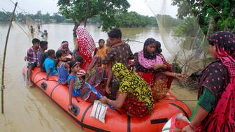 Flood-affected villagers are moved to a safer place after heavy rains at Pratapgarh village on the outskirts of Agartala, India, September 4, 2017. REUTERS/Jayanta Dey
