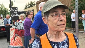 Patricia Canon, who volunteers escorting women past protestors, stands outside the EMW WomenÕs Surgical Center in Louisville, Kentucky, U.S. July 8, 2017. Picture taken July 8, 2017. REUTERS/Chris Kenning
