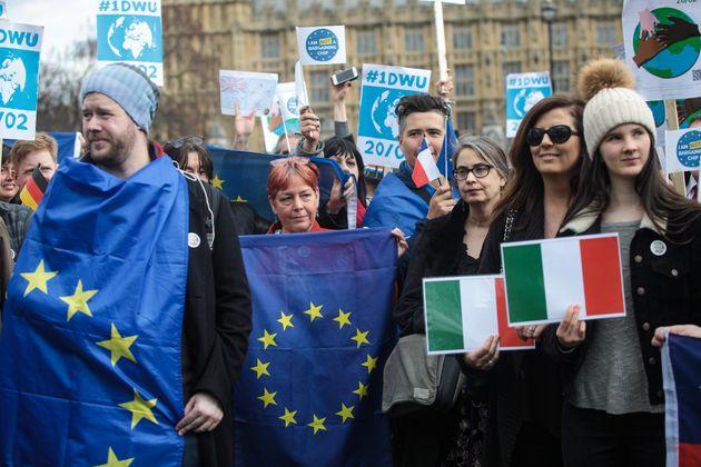 EU migrants demonstrate outside