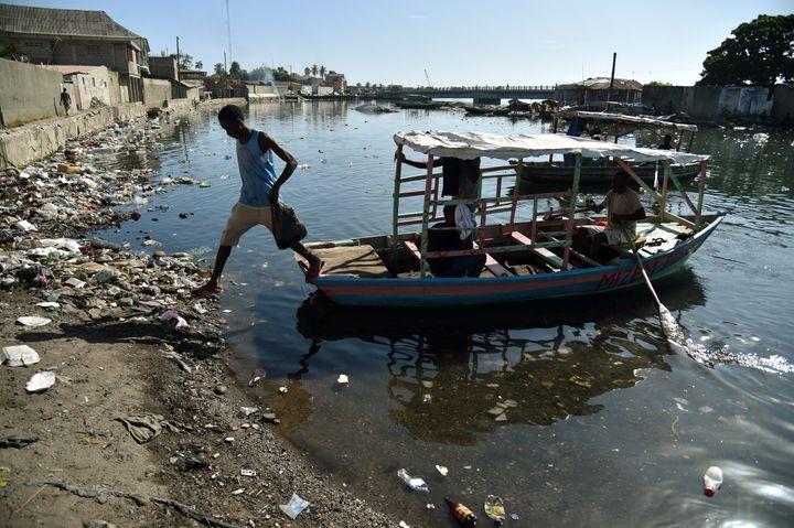 A man jump fron a boat in Mapou River in Cap-Haitien, Haiti, on September 6, 2017. Inhabitants of Shada, a poor riverside com