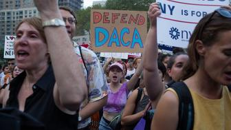 NEW YORK, NY - SEPTEMBER 5: Supporters of the Deferred Action for Childhood Arrivals immigration law demonstrate against President Trump's decision to cancel the program on September 5, 2017 in Foley Square in New York City. (Photo by Andrew Lichtenstein/Corbis via Getty Images)