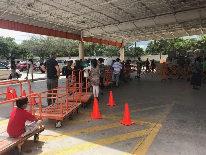 Fort Lauderdale-area residents line up for sheets of plywood at aHome Depot as they prepare for the arrival of Hurrican