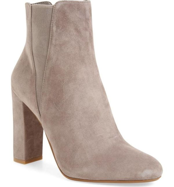 "We're all about breaking ""rules"" here, so let's talk about how ankle booties <i>can</i> be worn with midi skirts. Go wit"