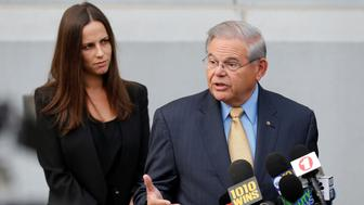 Senator Bob Menendez (R) speaks to journalists after arriving to face trial for federal corruption charges as his daughter Alicia Menendez looks on outside United States District Court for the District of New Jersey in Newark, New Jersey, U.S., September 6, 2017. REUTERS/Joe Penney