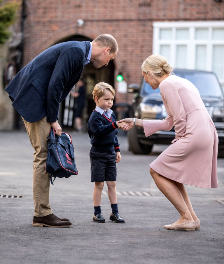 Helen Haslem, head of the lower school greeting Prince George and the Duke of Cambridge at Thomas's Battersea in London, as he starts his first day of school.
