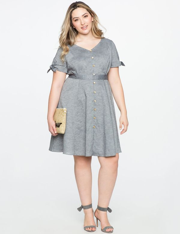 """<a href=""""http://www.eloquii.com/button-down-fit-and-flare-dress/1234429.html?cgid=2628-dresses&dwvar_1234429_colorCode=3&"""