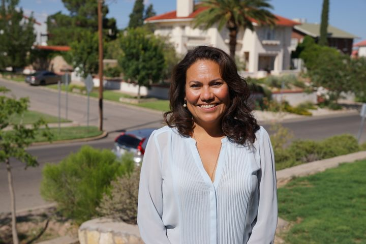 Veronica Escobar, 47, stands in her front yard in El Paso, Texas. She is hoping to be the first Latina Texas has ever elected