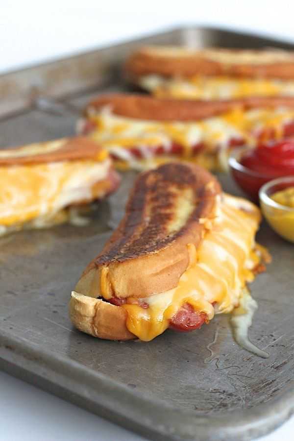 "<strong>Get the <a href=""http://thebakermama.com/recipes/grilled-cheese-hot-dogs/"" target=""_blank"">Grilled Cheese Hot Dogs re"