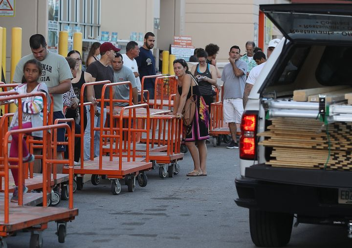 People wait in line to purchase plywood at Home Depot in Miami as they prepare for Hurricane Irma on Sept. 6, 2017.