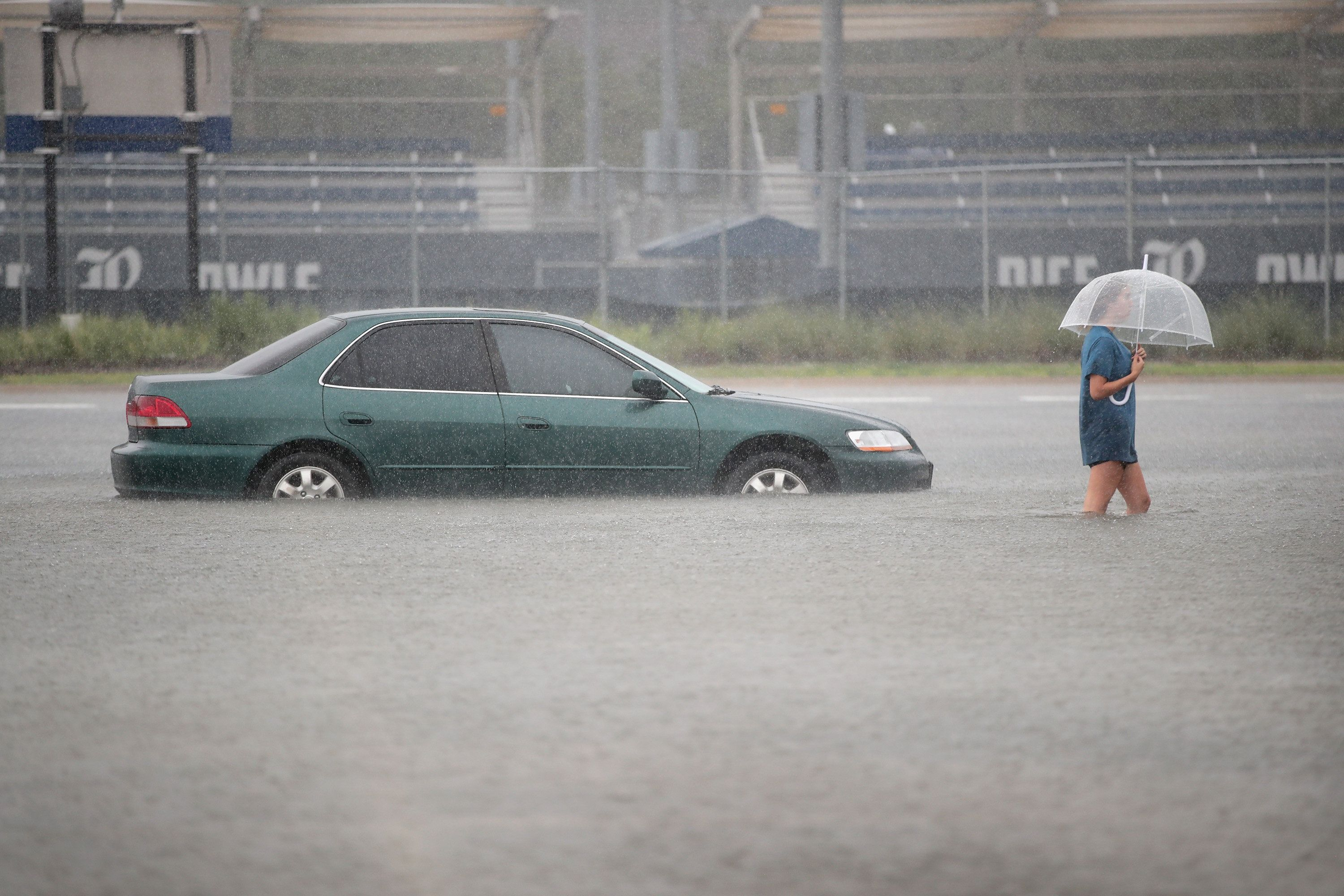 A woman walks through a flooded parking lot at Rice University in Houston last week.