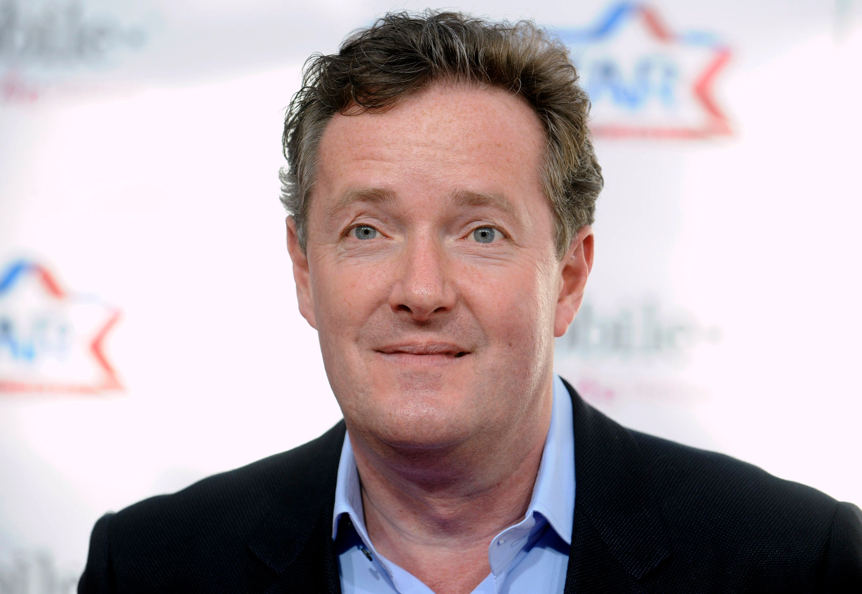 Piers Morgan arrives at the T-Mobile Magenta Carpet pre NBA All-Star Game event in Los Angeles on February 20, 2011. REUTERS/Phil McCarten (UNITED STATES - Tags: ENTERTAINMENT HEADSHOT)