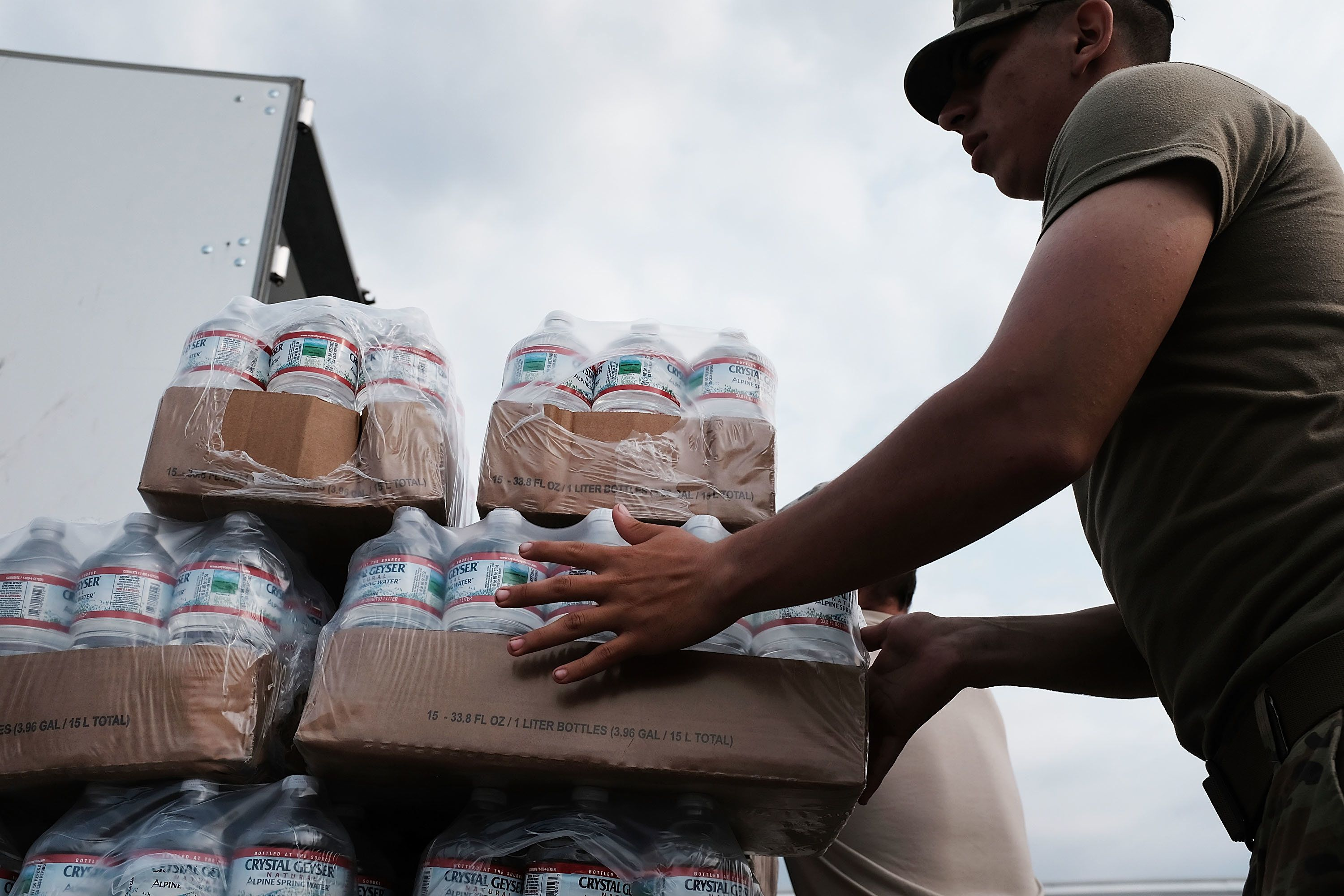ORANGE, TX - SEPTEMBER 06:  Members of the Texas National Guard prepare to distribute water and emergency meals as Texas slowly moves toward recovery from the devastation of Hurricane Harvey on September 6, 2017 in Orange, Texas. Almost a week after Hurricane Harvey ravaged parts of the state, some neighborhoods still remained flooded and without electricity. While downtown Houston is returning to business, thousands continue to live in shelters, hotels and other accommodations as they contemplate their future.  (Photo by Spencer Platt/Getty Images)