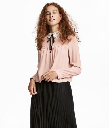 "Pictured: <a href=""http://www.hm.com/us/product/63479"" target=""_blank"">Blouse with lace collar from H&M</a>"