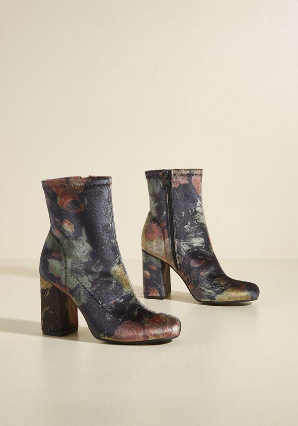 "Shop them <a href=""https://www.modcloth.com/shop/newarrivals/transformative-trot-velvet-block-heel-bootie/153748.html?dwvar_1"