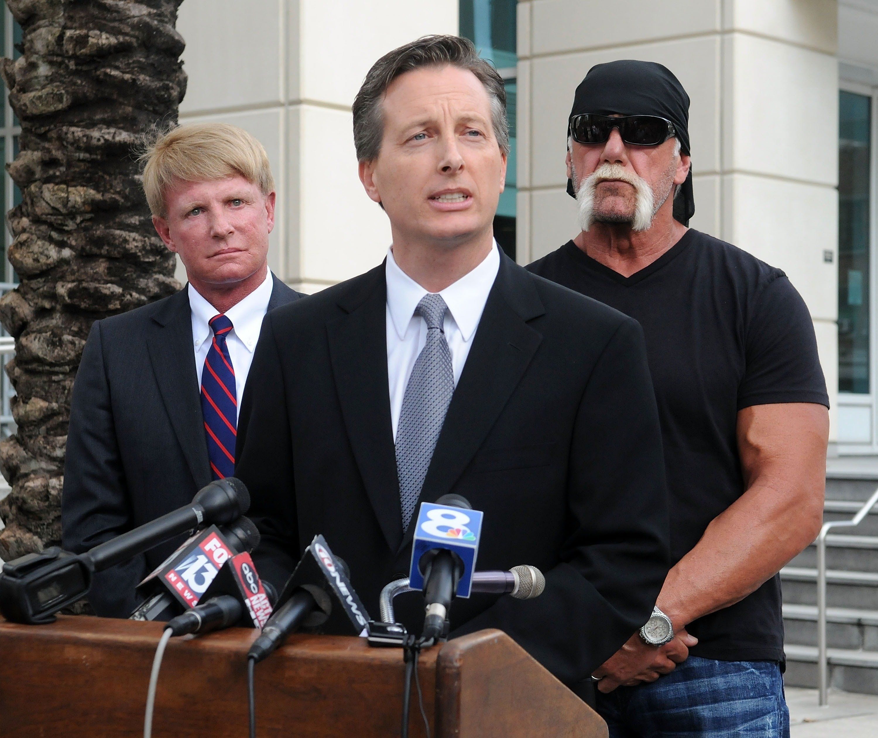 TAMPA, FL - OCTOBER 15:  TV personality Terry Bollea aka Hulk Hogan (R) and his attorneys David Houston (L) and Charles Harder (C) attend for a press conference to discuss legal action being brought on his behalf October 15, 2012 in Tampa, Florida.  Counsel will discuss the two civil lawsuits suits being filed today.  The first is a state court action against Heather Clem and Bubba the Love Sponge Clem. The second is a federal court action against Gawker Media.  (Photo by Gerardo Mora/Getty Images)