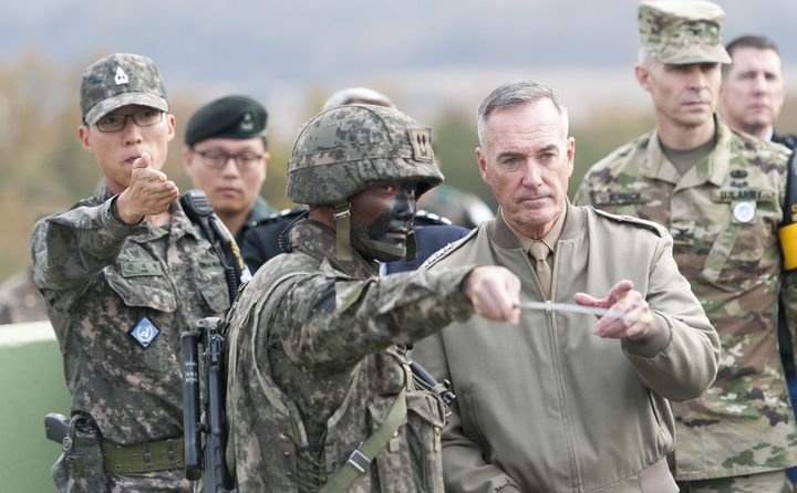 Gen. Joseph F. Dunford, Chairman of the Joint Chiefs of Staff, being briefed by U.S. Army Col. James Minnich, during a visit