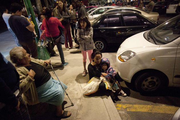 At least two people are dead after a 8.1-magnitude earthquake hit the coast of Mexico; people are pictured...