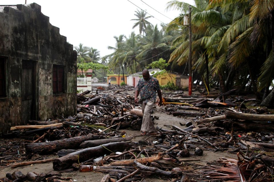 A man in the Dominican Republic surveys the devastation wreaked by the