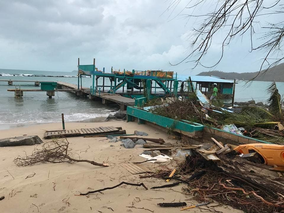 A pier in Virgin Gorda is reduced to matchwood by Hurricane