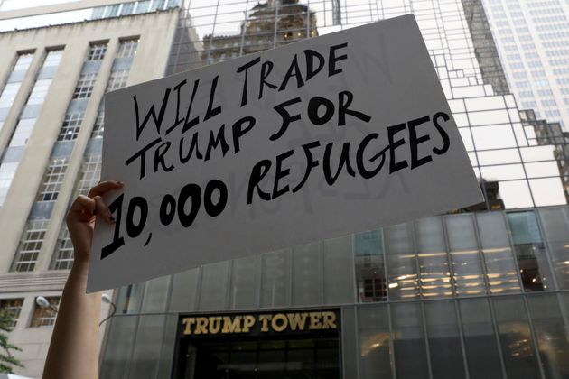 Protestors outside Trump Tower, New York where the meeting was